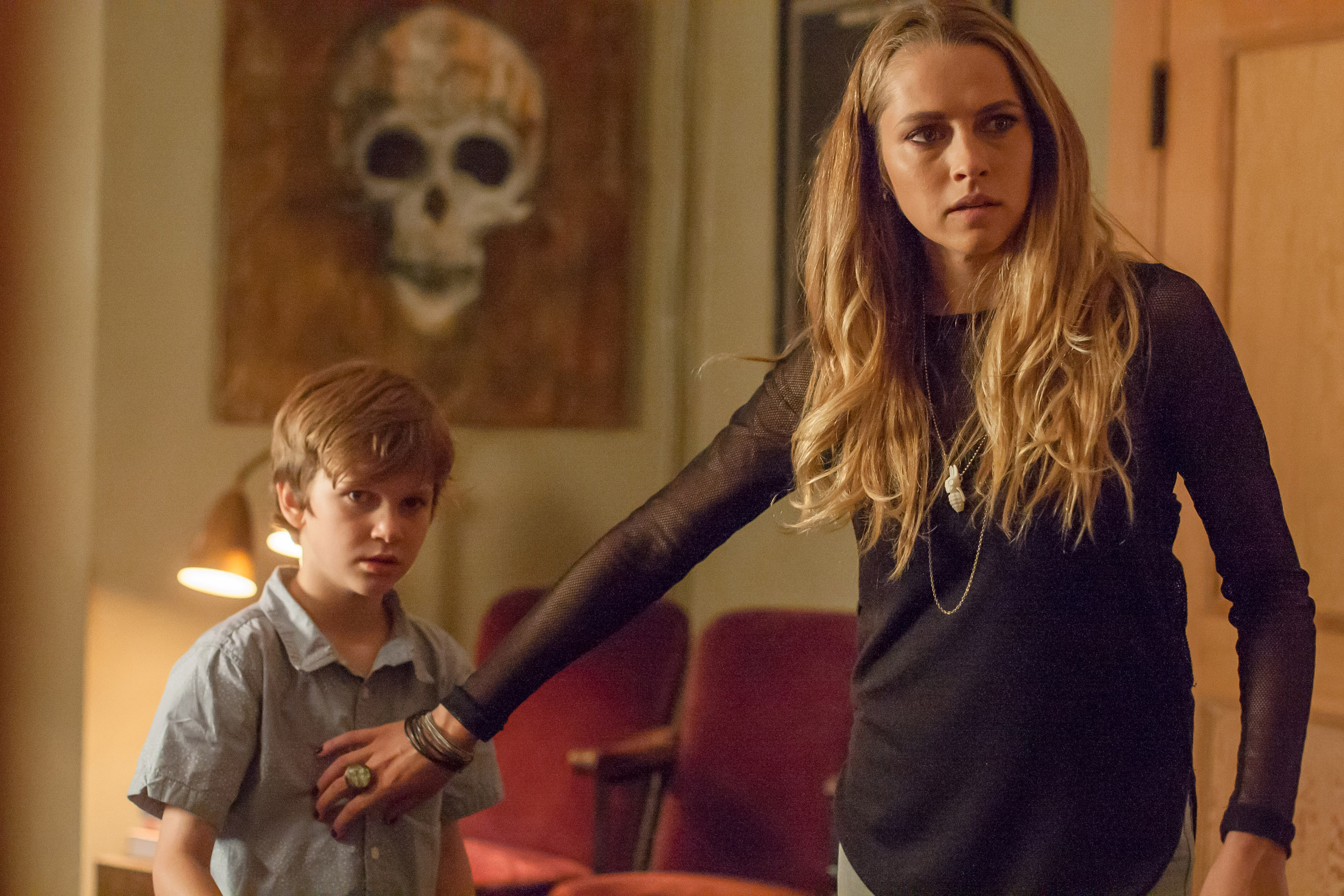 "In this image released by Warner Bros. Pictures, Gabriel Bateman, left, and Teresa Palmer appear in a scene from the horror film, ""Lights Out."" (Ron Batzdorff/Warner Bros. Pictures via AP)"