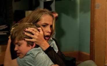 Gabriel Bateman and Teresa Palmer star in the big-screen adaptation of Lights Out, a film that began as a low-budget short, uploaded to YouTub