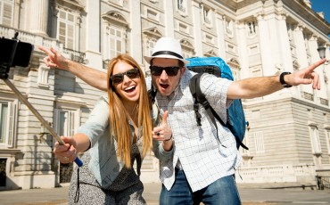 young beautiful friends tourist couple visiting Spain in holidays exchange students and taking selfie stick picture together in town happy on sunny day in travel and vacation concept; Shutterstock ID 255447802; PO: Brandon for Consumer